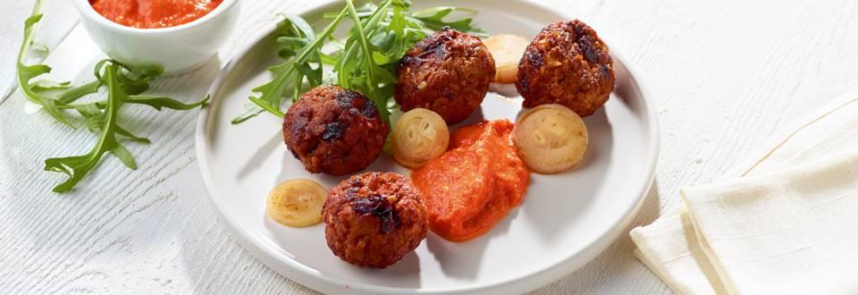 Boulettes de viande hachée aux raisins secs et tapenade de poivrons