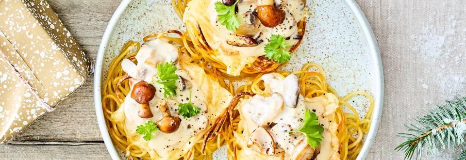 Nids de spaghettis farcis de raclette et champignons Deluxe